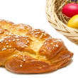 Stock Photo: Home made sweet braided bread with easter eggs