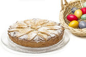 """Home-made """"Ruebli-Pie"""" cake and basket with easter eggs — Stock Photo"""