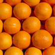 Fresh oranges as background — Stock Photo