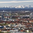 Munich with view of the bavarian alps at foehn wind - Stock Photo