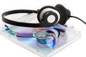 Compact Discs (CDs) with headphones — Stock Photo