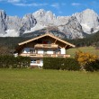 "Farmhouse at ""Zahmer Kaiser"" mountains in Tyrol, Austria - Stock Photo"