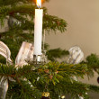 Christmas decoration with burning candle — Stock Photo
