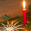 Christmas decoration with candle and straw star — Stock Photo