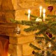 Christmas decoration with burning candles — Stock Photo
