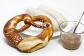 Fresh Bavarian white sausage, pretzel and mustard — Stock Photo