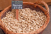Peanuts in a market basket — Stock Photo