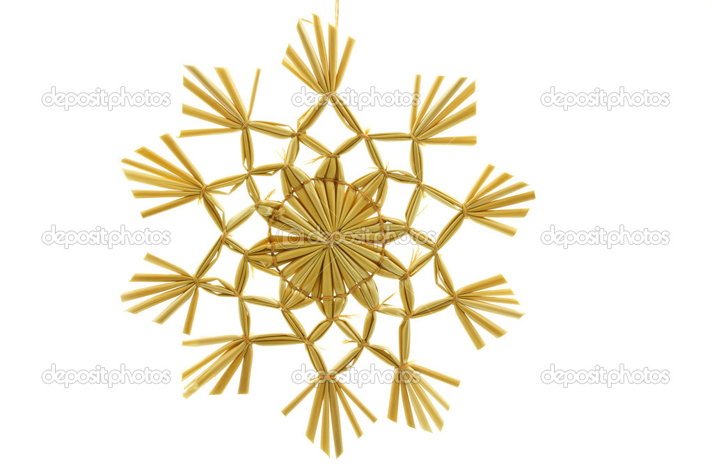 Straw star for a christmas tree on white background — Photo #9176350
