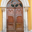 Antique wooden door in Italy - 图库照片