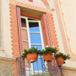 Stock Photo: Typical italibalcony with flower decoration