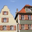 Facade of medieval houses in Dinkelsbuehl, Franconia, Germany - Stock Photo