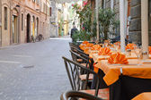 Italian restaurant in the streets of Como, Italy — Stock Photo