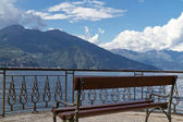 Bench overlooking lake Como in Italy — Stock Photo