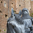 Knight with horse in front of Mont Orgueil Castle in Gorey, Jersey, UK - Stock Photo