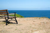 Bench looking out to the sea on coast of Jersey, UK — Stock Photo