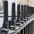 Wrought iron spike fence - Stock Photo