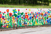 Wall painting made by kids — Stock Photo