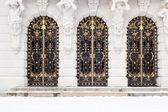 Three wrought iron doors — Stock Photo