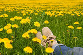 Person relaxing in a spring meadow — Stock Photo