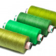 Bobbins of thread on white background — Stock Photo