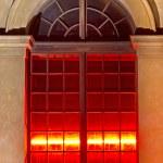 Illuminated historic window in Munich, Germany — Stock Photo #9777673