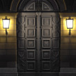 Stock Photo: Two lanterns illuminating historic door