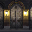 Two lanterns illuminating historic doors — Stock Photo