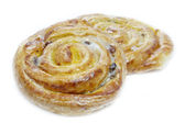 Danish pastries with raisins, vanilla creme and sugar icing — Stock Photo