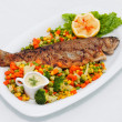 Roasted fish with vegetables — Stock Photo