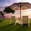 Beach chairs on perfect tropical white sand beach — Stock Photo #9244763