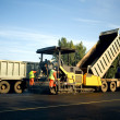 Asphalt spreader in work — Stock Photo