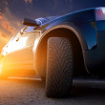 Motion blurred car on asphalt road — Stock Photo