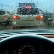 Kind on highway through wet glass — Stock Photo