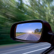 Stock Photo: Blurred action from car at high speed
