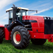 The Tractor on a green field — Stock Photo