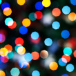 Blurred festive colorful lights over black useful as background — Stock Photo #9246300