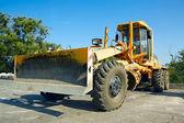 Bulldozer in the parking lot. — Stock Photo