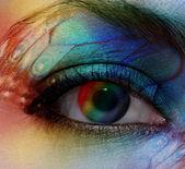 Beautiful female eye with make-up rainbow — Stock Photo