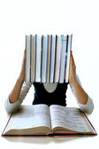 The girl and is a lot of textbooks. It is isolated — Stock Photo