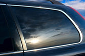 The sunset is reflected in car glass — Стоковое фото