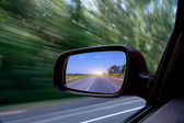 Blurred action from car at high speed — Stock Photo