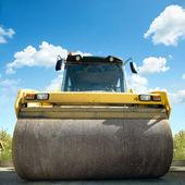 Orange road-roller on repairing of the road — Stock Photo