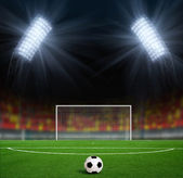 Green football ground against the sky — Stock Photo