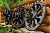 Old wheels from a cart — Stok fotoğraf