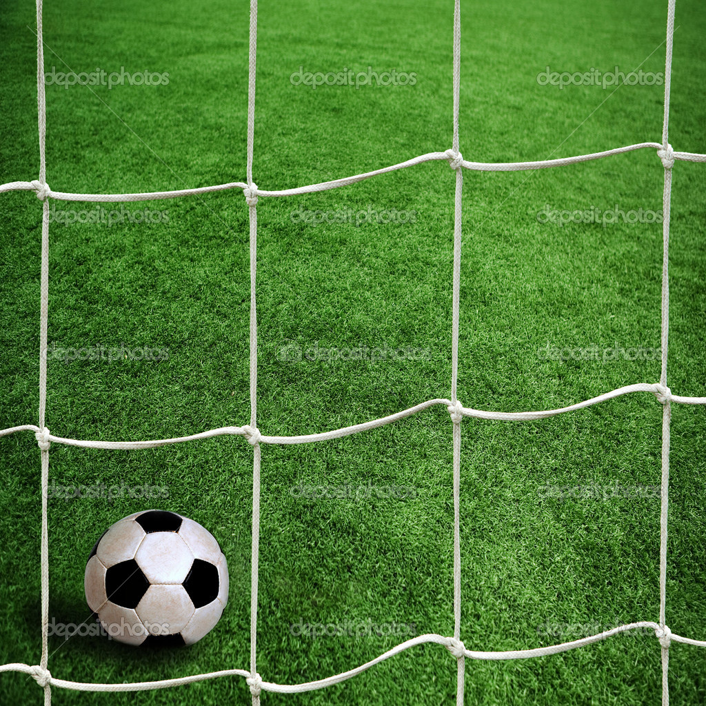 Soccer ball on green grass  Stock Photo #9245946