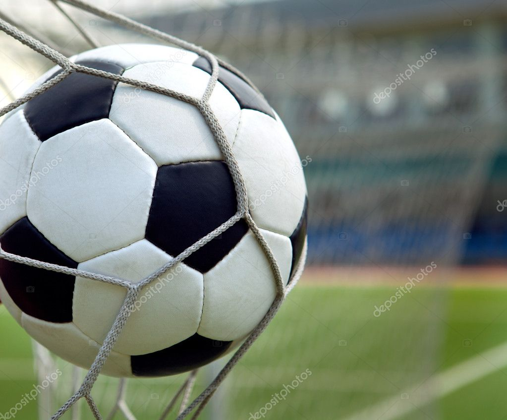 Football. The ball flies into the net gate  Stock Photo #9246345