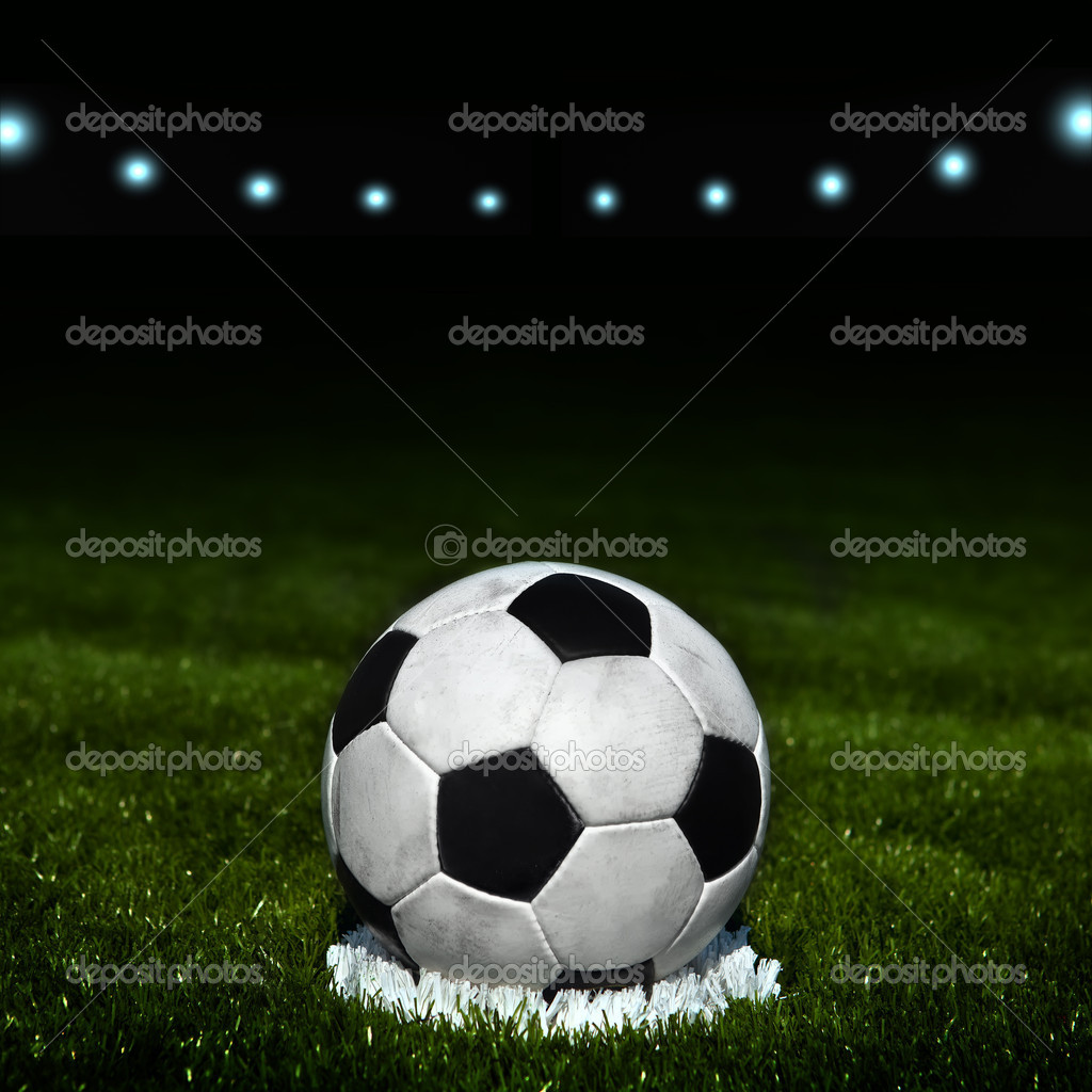 Soccer ball on the field of stadium with light — Stock Photo #9246352