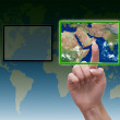 Hand pressing touchscreen button on the world background — Stock Photo
