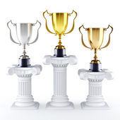 Gold silver and bronze trophy's on a pedestal — Stock Photo