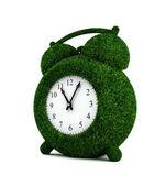 Grassed alarm clock — Stock Photo